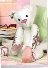 Rosie the Ballerina Bear beautifully decorated By Margaret Timmins having Adapted a pattern by Judy Gray.
